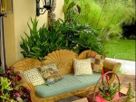 A cool tropical patio with lush landscape